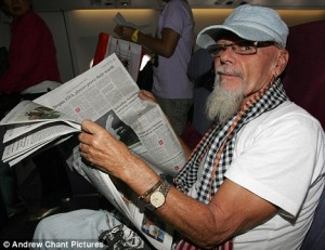 gary-glitter-reading-paper-on-aircraft5