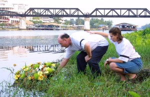 The Arscott and Lloyd families visit Thailand to Meet with Thai Officials and Pay Respect to their children, Vanessa Arscott and Adam Lloyd, who were gunned down by a Thai policeman in Kanchanaburi, Thailand Graham and Alyssa Arscott float a wreath on to the 'Kwae Noi' river in Kanchanaburi. The Bridge Over The River Kwai in the background.