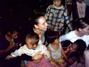 Holiday snaps from Vannessa Arscott and Adam Lloyd, taken just before they were murdered in Kanchanaburi by Thai police officer Somchai Wisetsingh. Vannessa surrounded by hill-tribe children, Northern Thailand.