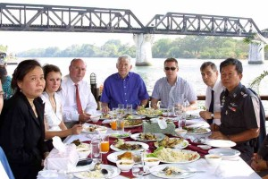 The Arscott and Lloyd families visit Thailand to Meet with Thai Officials and Pay Respect to their children, Vanessa Arscott and Adam Lloyd, who were gunned down by a Thai policeman in Kanchanaburi, Thailand. Lunch at the Bridge Over The River Kwai with the Head of Kanchanaburi Police. Left to right: British embassy translator, Alyssa Arscott, Graham Arscott, Brian Lloyd, Chris Loyd, Peter Kamry (Vice consul Brit Embassy) Pol. Maj General Chaichan Kitichan