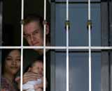 David Scott, 35, from Swindon with his partner Cynthia, 29 Delfino and their 1 month old daughter Janina at a hideout on the outskirts of the Philippine capital Manila. The couple have been charged with adultery under Philippine law where divorce is illegal because Cynthia is married to a Filipino man.
