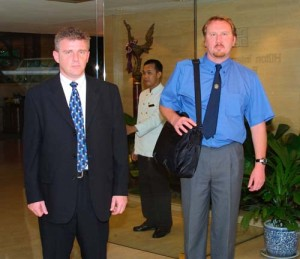 Chief Inspector Steven Wilkins (left) and Crime Scene Manager Richard Griffith, of Dyfed Powys Police leave the Hilton Hotel in Bangkok, Thailand, after picking up the evidence in the Kirsty Jones murder case from the Royal Thai Police.