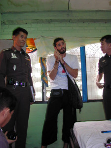 Nathan Foley, 26, with police at the Aree Guest House, Chiang Mai, where former Liverpool University student Kirsty Jones was found murdered on August 10 2000, Foley was arrested on suspicion of murder