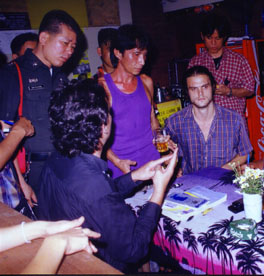 Stephen Trigg(right) being interviewed by police with manager of 'Aree' Guest house in Chiang Mai, where Kirsty Jones was found murdered