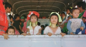 Padaung long-necked hill tribe girls on a truck after being released from a Thai tourist attraction where they were held in captivity.